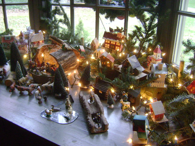 Village in the bay window.Christmas at Vintage American Home