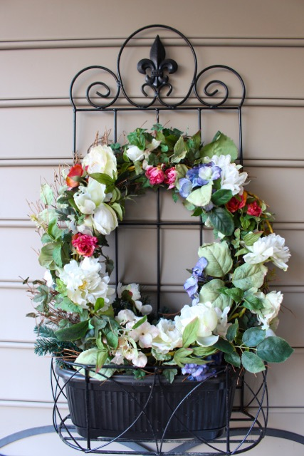 Front Porch decorating with spring wreath. Ideas from Vintage American Home Blog