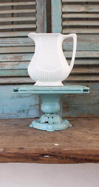 Blue metal pedestal available at Vintage American Home.