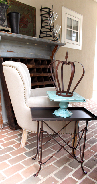 Charming metal end table with paw feet at Vintage American Home.com