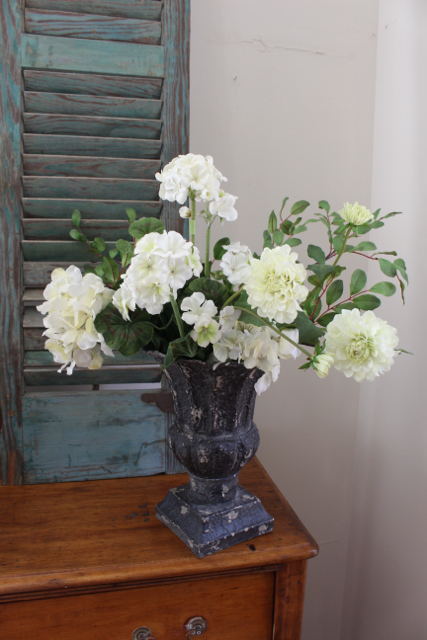 Metal urn with hydrangeas available at Vintage American Home. com online store.