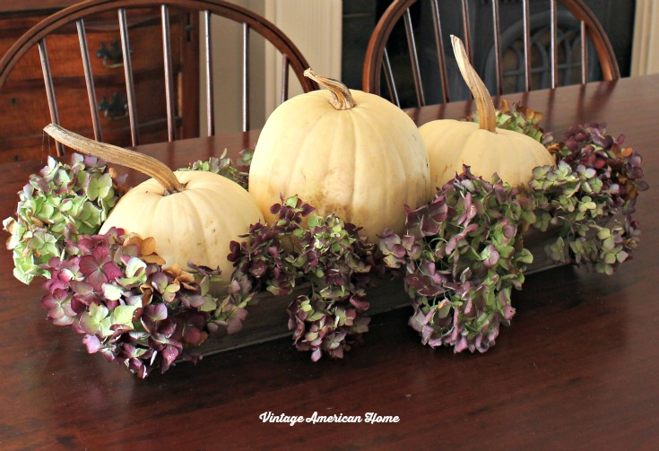 Tablescape for Thaksgiving.  White pumpkin fall arrangement with hydrangeas from Vintage American Home.