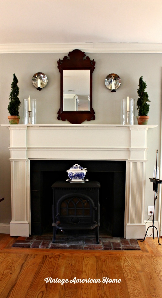 mantel with Navajo White by Benjamin Moore paint, Revere Pewter, chippendale mirror in dining room.  See more at Vintage American Home.