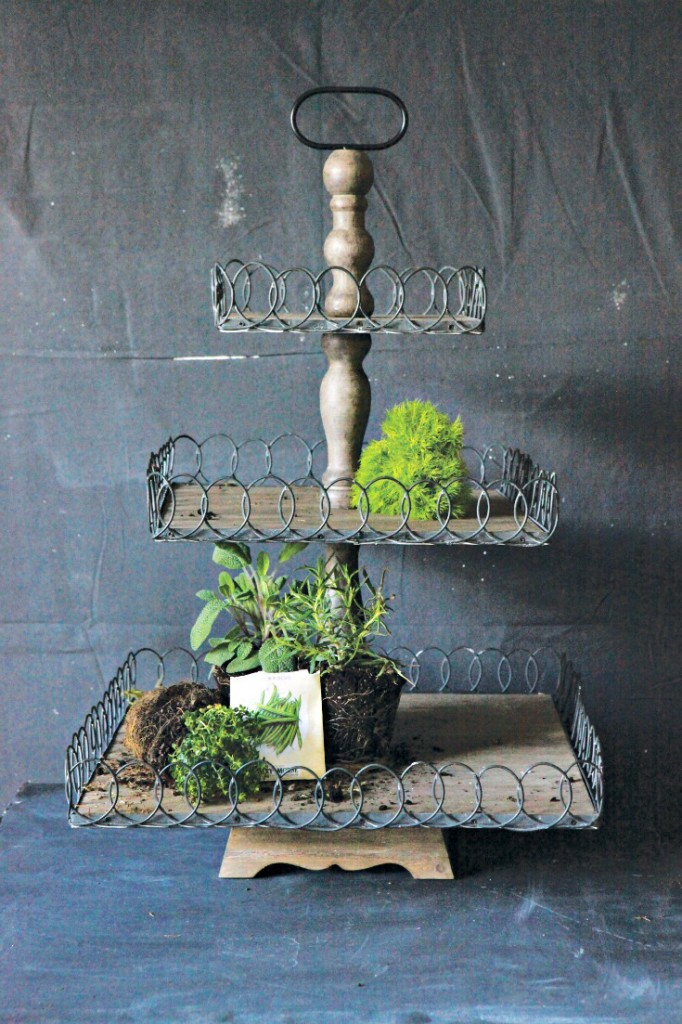 Wood and metal pedestal displays your favorite home decor items. Great centerpiece for your fixer upper if you like the new farmhouse style. Vintage American Home