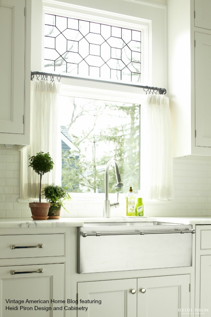 Farm sink with white cabinetry and marble counter. Heidi Piron Design and Cabinetry featured on Vintage American Home blog