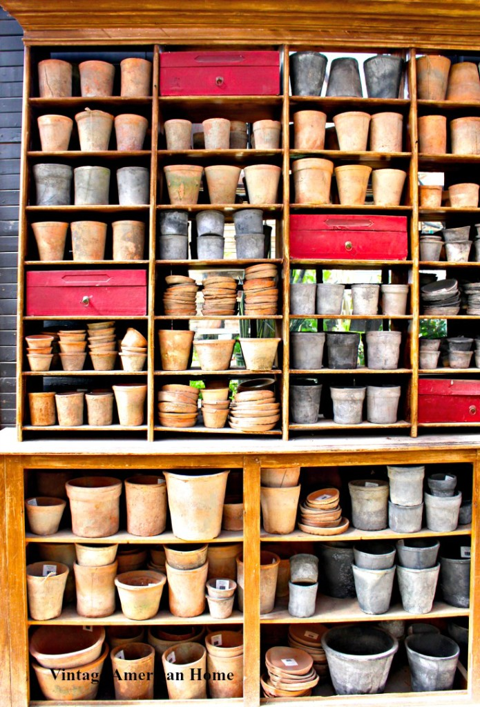 Spring Decorating shelf and clay pots for potting room and garden shed
