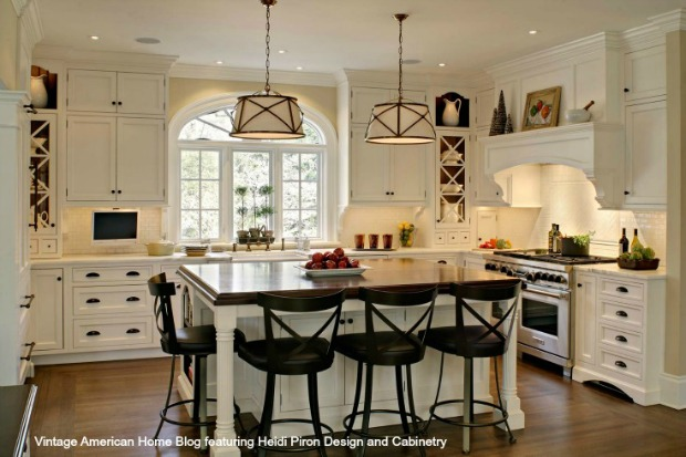 White-farm-kitchen-with-Bentwood-Bar-stools-farm-sink-pendant-lighting-hardwood-floors-and-vintage-ironstone.-Design-by-Heidi-Piron-Design-and-Cabinetry.jpg
