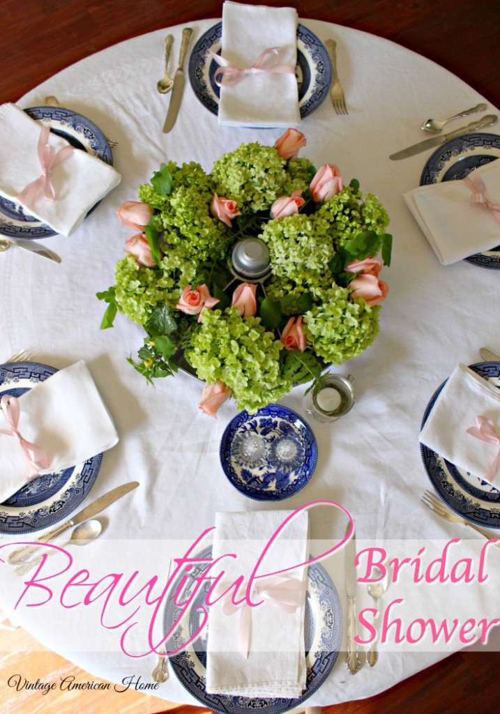 Round bridal shower table with pink ribbons, roses, centerpiece in round aluminum cubby, willow ware, silver plate