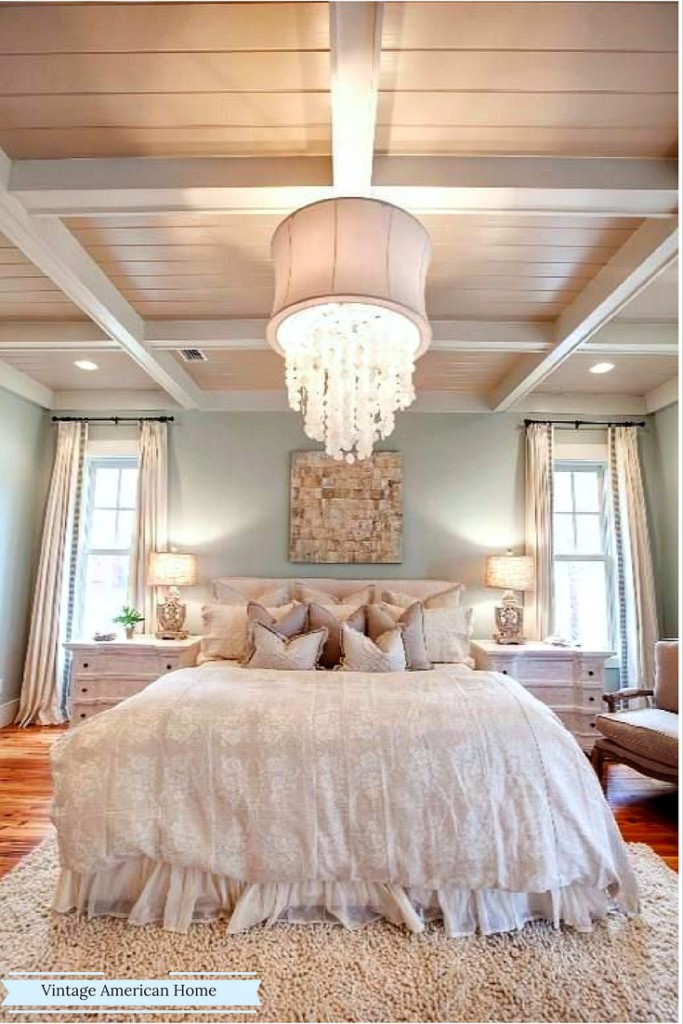 Gorgeous chandelier in luxurious bedroom, coffered ceiling.  More at Vintage American Home.