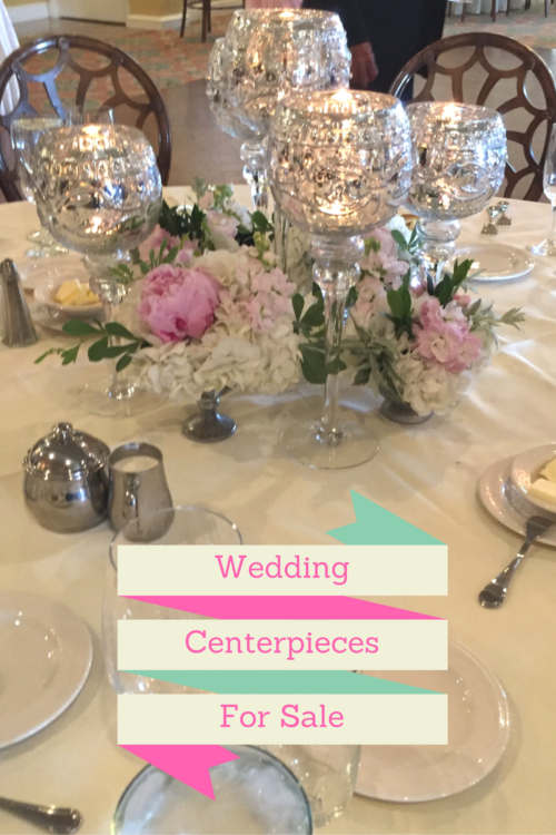 Wedding centerpiece with mercury glass goblets with votive candles and small footed containers with blush and pink peopnies, roses and hydrangeas. Goblets for sale at Vintage American HOme.
