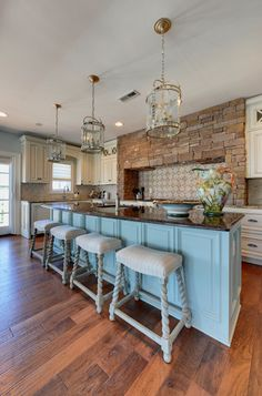 Using lanterns as pendants for islands in a fixer upper kitchen