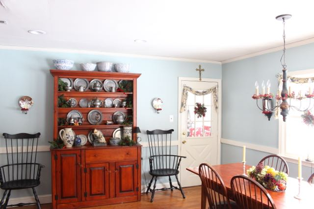 Blue paint goes with brown cabinets.